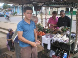 A son and his father at their roadside farm market