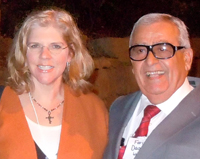 Carol Dolezal-Ng and Elder Faris Dagher standing together.