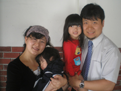 Heea Lee and Joey Chang, with Joey holding his young daughter, Lydia.