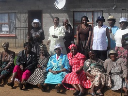 A group of Lesotho women together for a photo.