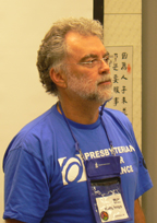 The Rev. Bill Humphreys in a blue Presbyterian Disaster Assistance t-shirt with a badge holder.