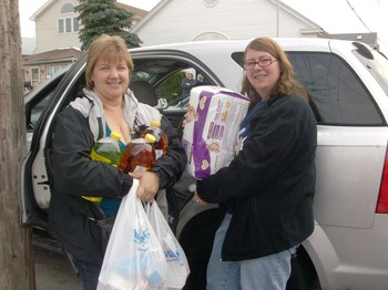 "Karen and Ann Mohr, former residents of Breezy Point, returned ""home"" to bring relief supplies to stricken neighbors."