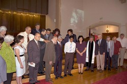 Members of the Mideast Evangelical Church in South Pasadena pray for Maher Makar.