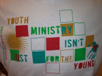 "A multicolored banner that says ""Youth ministry isn't just for the young!""."