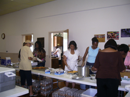 Women from Brown Memorial Presbyterian Church assembling 200 lunches for delivery to Rosedale Court homes.