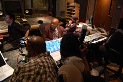 A group of people in a recording studio.