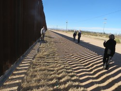 The wall keeping migrants from crossing along border towns.