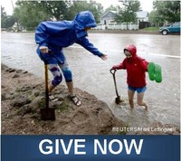woman helping child onto dry ground