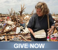 Woman holding a Bible found amidst tornado rubble