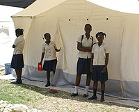 Girls in front of a tent
