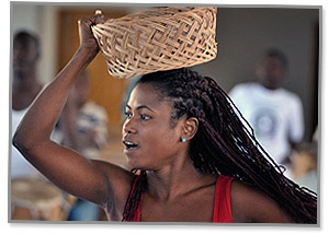 Haitian woman with basket on head