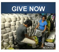 NCCP volunteers loading supplies into a bag in front of a pile of relief supplies