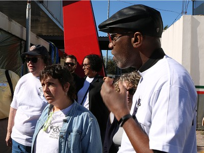 The Rev. Dr. J. Herbert Nelson, II, Stated Clerk of the General Assembly, right, and Valerie Young, left, with Synod of the Sun, listen as families share their stories at the Mexico border. (Photo by Rick Jones)