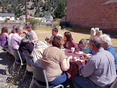 Every Sunday after worship the Basin Presbyterian New Worshipping Community in Montana meets for a shared, home-cooked meal with visitors that are in town.  This is one of their summer meals held outdoors in the neighboring park. Photo by NWC Evangelist/Pastor Ok-Kee Kim.