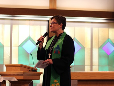 Rev. Cindy Kohlmann speaks at Travis Air Force Base in California. Photo by Rick Jones.