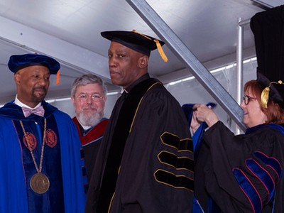 Rev. Dr. J. Herbert Nelson, II, receives an honorary doctorate of divinity degree during commencement at New Brunswick Theological Seminary. Photo by Allison Brown.