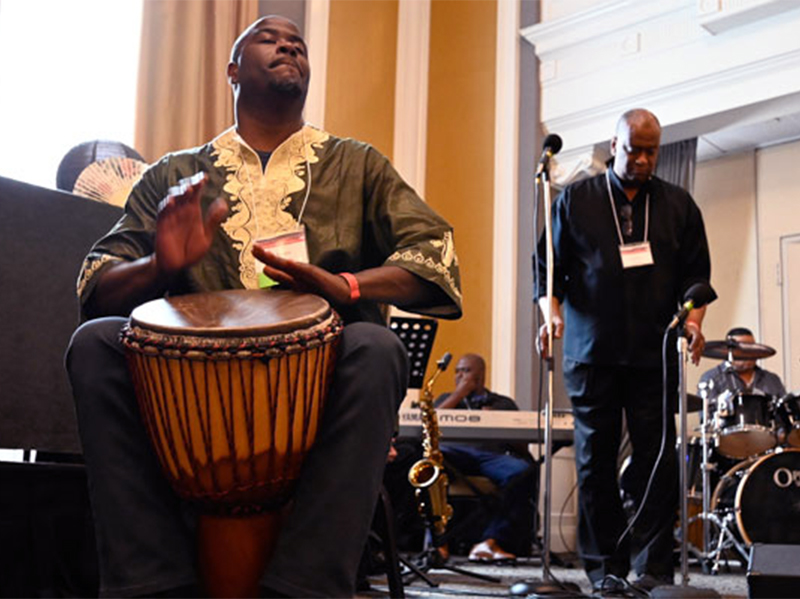 The Rev. Alonzo Johnson provided powerful drumming during the Convocation for Communities of Color. (Photo by Rich Copley)