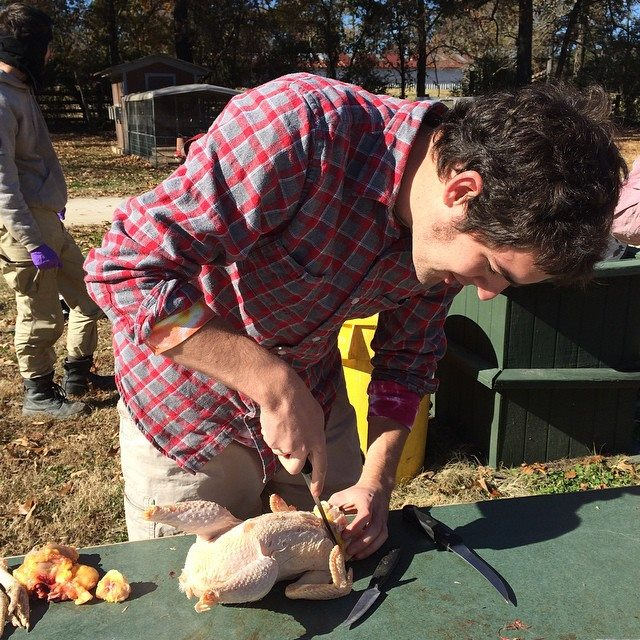 Picture of me removing the chicken's crop and cutting the organs away from the neck bone. Photo taken by Molly DeWitt, Copywrite 2014