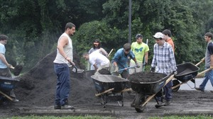 FPC Howard County youth carrying mulch for rain garden