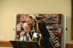 C. Lynn Cox hands an award to the Rev David E. Young