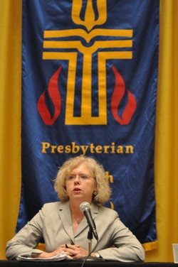 Photo of a woman at a podium