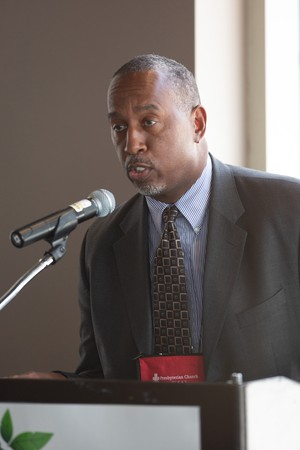 The Rev. Jimmie Hawkins speaks at the Earth Care Luncheon on Tuesday, June 19.