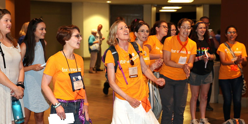 Presbyterian Peace Fellowship and Fossil Free PCUSA representatives opening of the 223rd General Assembly on Friday encouraging corporate divestment from fossil fuels. (Photo by Danny Bolin)
