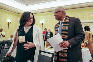 Rev. Dr. Thomas H. Priest Jr and Stefanie Lewis talking before opening ceremonies of the National Black Presbyterian Caucus dinner.