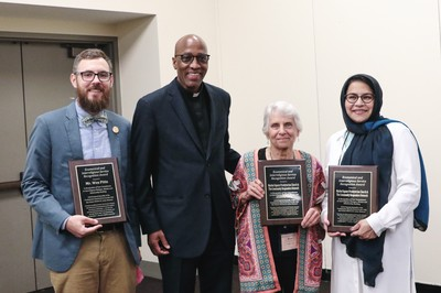 Stated Clerk J. Herbert Nelson, II stands with Ecumenical and Interreligious Service Award winners Wes Pitts, Margee Kooistra and Farzama Q. Safiullah.