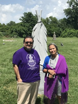 Ivy Porter and Jo Ann Kauffman visit gravesite of Speaking Eagle