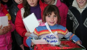 Girl holding Christmas package