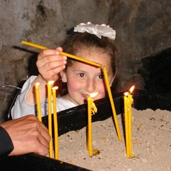 Girl lighting candles