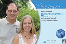 A prayer card with Richard and Debbie Welch