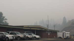 Smoke from the Clearwater Complex of fires hangs over the incident command post in Kooskia, Idaho.