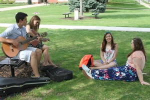 Caleb Chincoya sings with fellow students on the University of Dubuque quad.