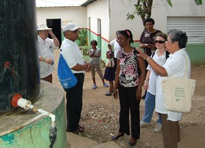 SDOP Task Force Member Cecilia Moran (far right) inspects a water project in the Dominican Republic. The Batey Relief Alliance and the Movement of Haitian-Dominican Women joined together to construct clean water systems in 11 bateys throughout the central and eastern regions. The systems provide clean water to approximately 8,700 people.