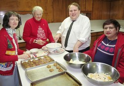 From left to right baking cookies at the Colby church: Regena Barnum, Merna Schroeder, Andy Sonneborn, Veronica Roopchan.