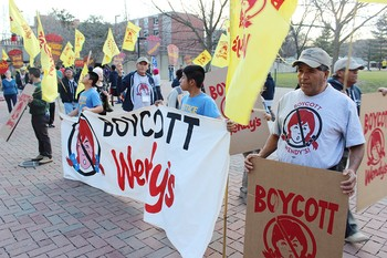 Supporters for the Coalition of Immokalee Workers take to the U of L campus to call for a boycott against Wendy's restaurants.
