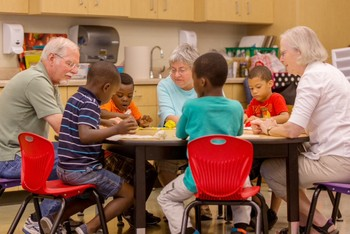 Volunteers from First Presbyterian Church and Altrusa Service Organization work with boys in the DREAAM House Summer Pre-K Academy.
