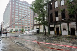 Louisville firefighters continue to contain fire and douse hot spots July 7, the day after a fire damaged historic buildings near the PC(USA) headquarters.