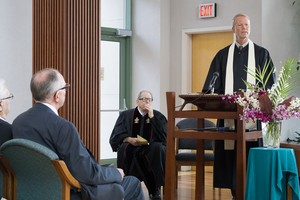 The Rev. David Maxwell (standing) preaches at the wedding of Paul Kempf and Robb Gwaltney on the familiar text on love from 1 Corinthians 13.