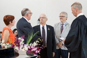 Paul Kempf and Robb Gwaltney (center l and r) exchange vows at the Presbyterian Center Chapel in Louisville.