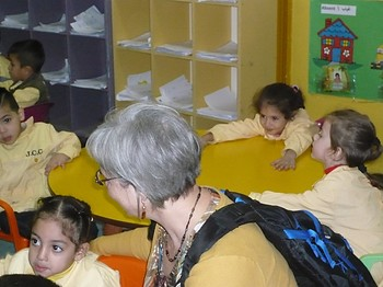 Elmarie Parker visits with Palestinian students attending a school sponsored by the Joint Christian Committee in Beirut, Lebanon.