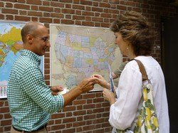 Mike Porter, Coordinator of Abbots/MAGs (Mission Affinity Groups), for the Fellowship Community, invited participants during registration to place a dot on their hometown on the U.S. or world map.