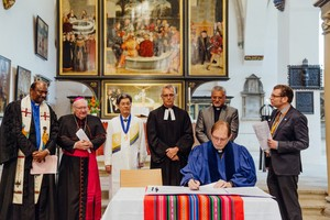 WCRC General Secretary Chris Ferguson signs the historic document pledging to heal divisions in Christendom brought on by the Protestant Reformation.