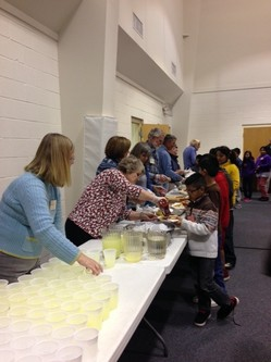 Church volunteers provide refreshments for students participating in after-school tutoring program.
