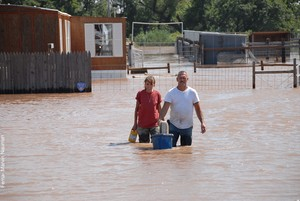 A couple leaves their home following flooding in Oklahoma.