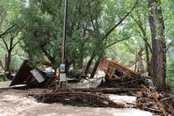 Flash flooding at Ghost Ranch destroyed the workshop areas of Pot Hollow, Short House and the Pole Barn, where ceramics and welding course were held.
