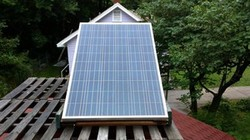 Noah Wilding uses this solar panel to power his lawn care equipment.