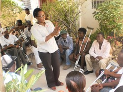 A social worker meets with those facing the challenges of disabilities in Haiti as part of Service Chretien d'Haiti's efforts to provide psychosocial support